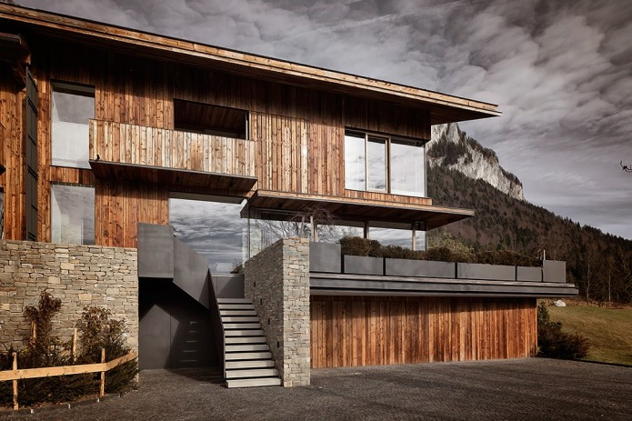 wood panel home in mountains